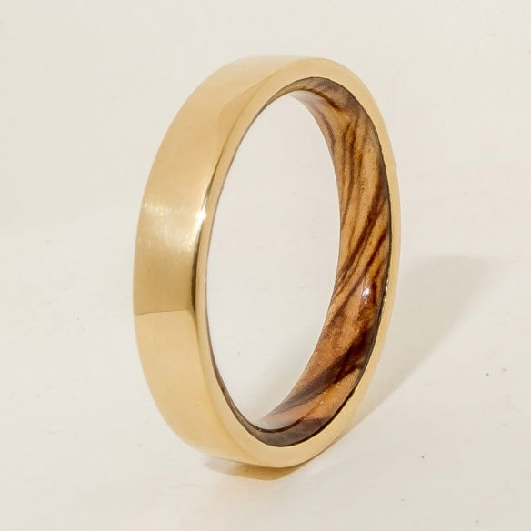 Gold wood bands 18k gold ring and olive wood inside 490,00 € Viademonte Jewelry
